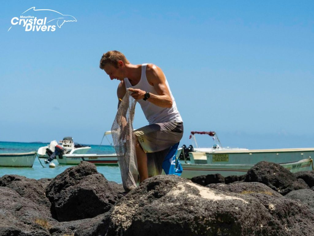 A Professional PADI Instructor during a Project AWARE Beach Clean Up with Crystal Divers Mauritius 5 Star IDC Centre to help preserve our ocean